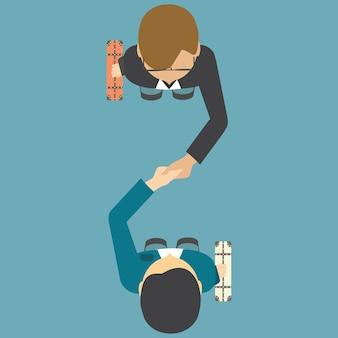 Vista dall'alto di due persone che si stringono la mano.