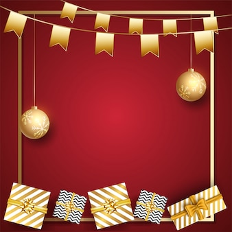 Vista dall'alto di scatole regalo con pendenti bagattelle dorate e bandiere per feste decorate su rosso