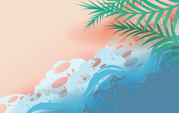 Vista dall'alto onde tropicali di foglie e mare sulla spiaggia.