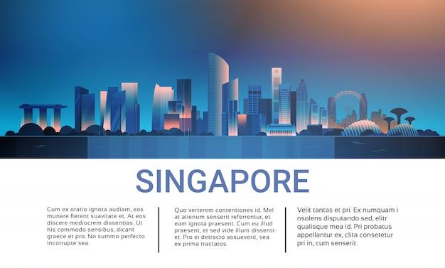 Vista di paesaggio urbano di notte di singapore con l'insegna del modello dei grattacieli e dei punti di riferimento famosi