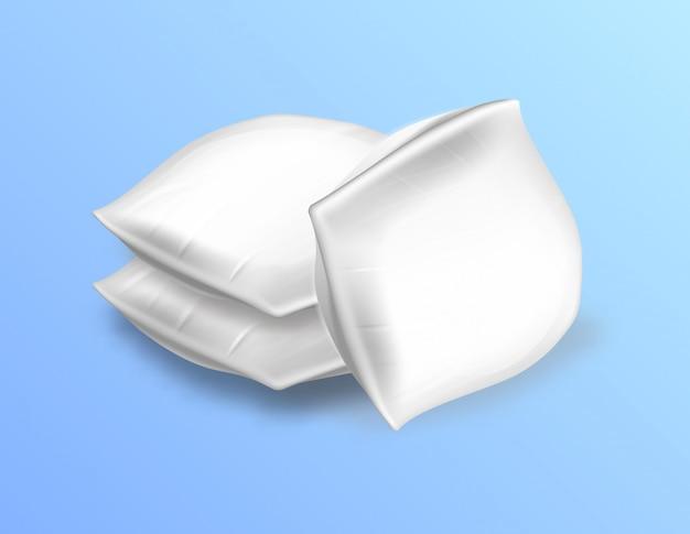 Vista laterale di morbidi cuscini rettangolari vuoti