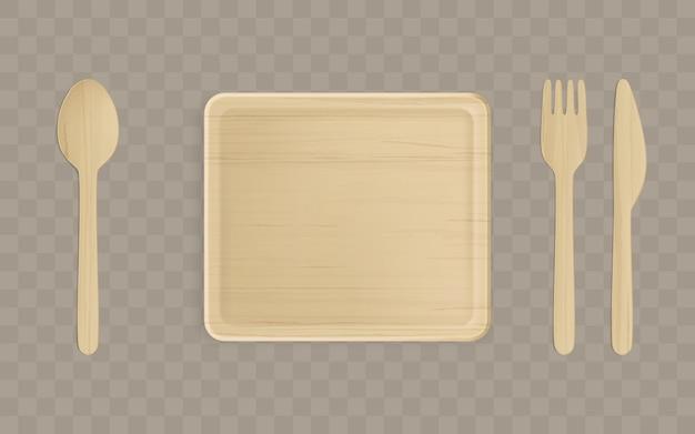 Vista superiore di legno del piatto, della forchetta, del cucchiaio e del coltello.