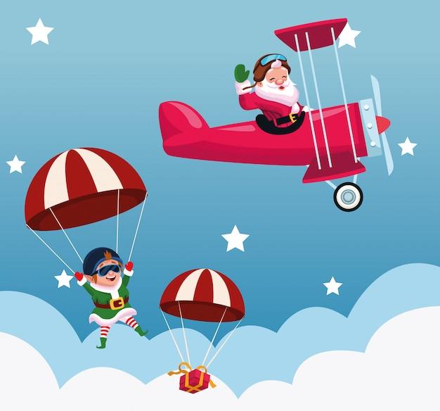 Volo del babbo natale del fumetto in un aeroplano e paracadute con l'elfo di natale e il contenitore di regalo