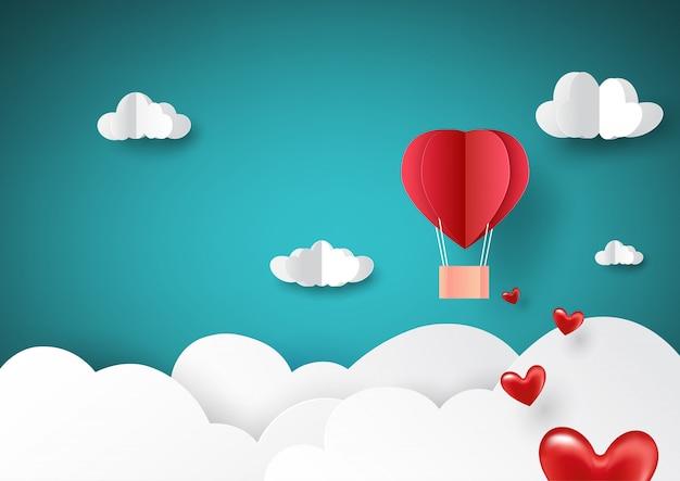 Volo dell'aerostato di aria calda rosso sul cielo con stile di arte di carta di concetto di amore.