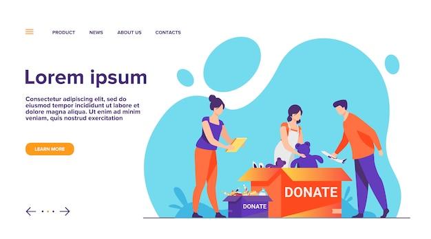 Volontari che imballano la pagina di destinazione delle scatole di donazione