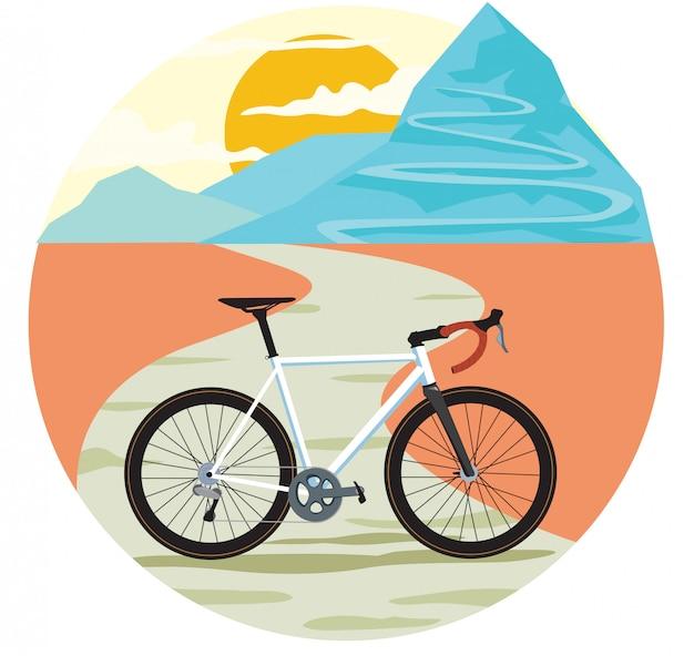Winding mountain road sun and road bike