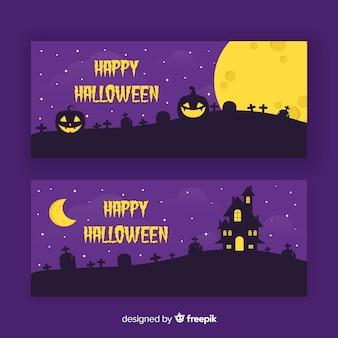 Zucche curve nelle insegne piane di halloween di notte