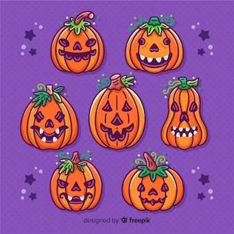 Zucche di halloween con foglie corona raccolta