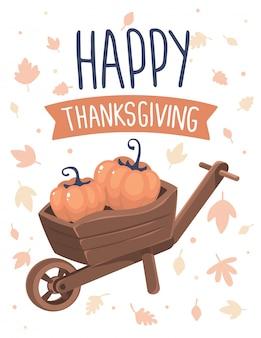 Zucche in carriola e testo felice ringraziamento con foglie di autunno su bianco