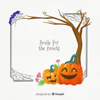Zucche sotto una struttura di halloween dell'albero