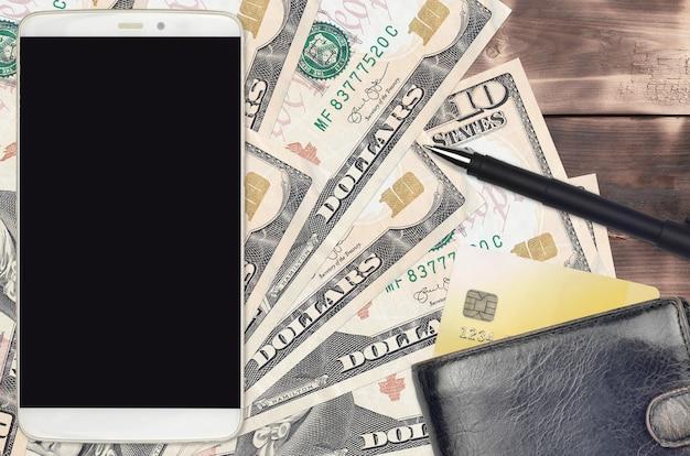 10 dollarbiljetten en smartphone met portemonnee en creditcard. e-betalingen of e-commerce concept.