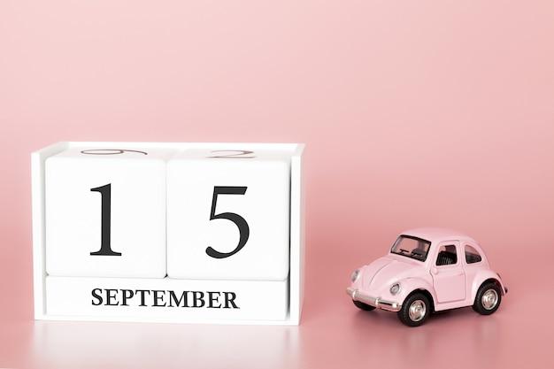 15 september. dag 15 van de maand. kalenderkubus met auto