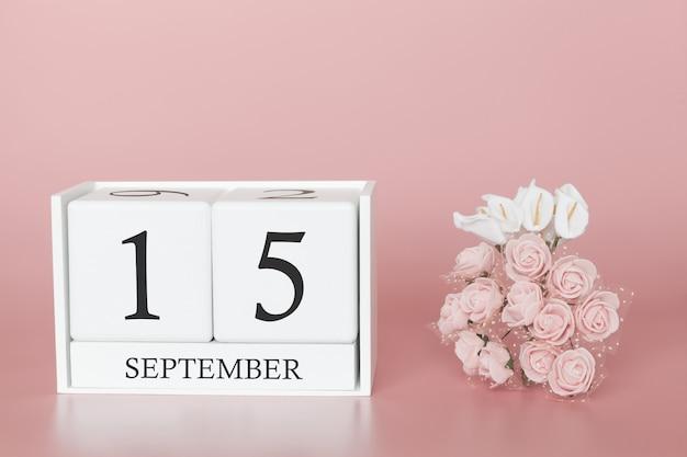 15 september. dag 15 van de maand. kalenderkubus op moderne roze achtergrond, concept zaken en een belangrijke gebeurtenis.
