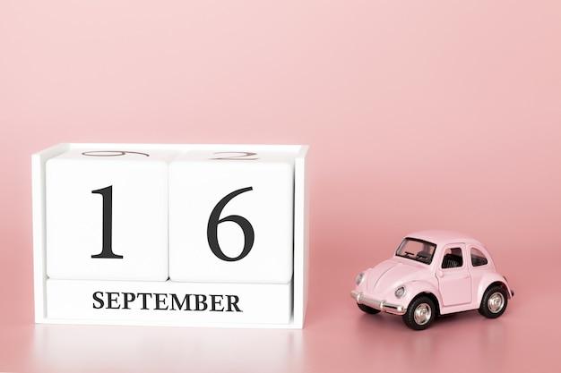 16 september. dag 16 van de maand. kalenderkubus met auto