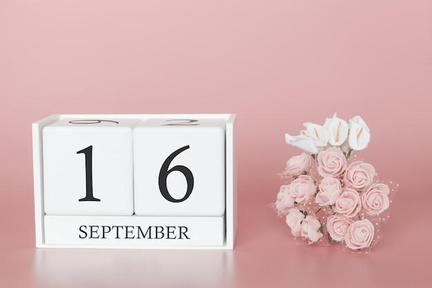 16 september. dag 16 van de maand. kalenderkubus op moderne roze achtergrond, concept zaken en een belangrijke gebeurtenis.