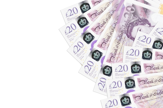 20 britse pond rekeningen ligt geïsoleerd op een witte achtergrond met kopie ruimte