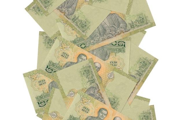 20 thaise baht-rekeningen vliegen naar beneden geïsoleerd op wit. veel bankbiljetten vallen met witte kopie ruimte aan de linker- en rechterkant