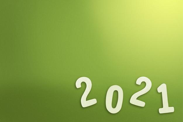 2021 op gekleurde achtergrond. gelukkig nieuwjaar 2021