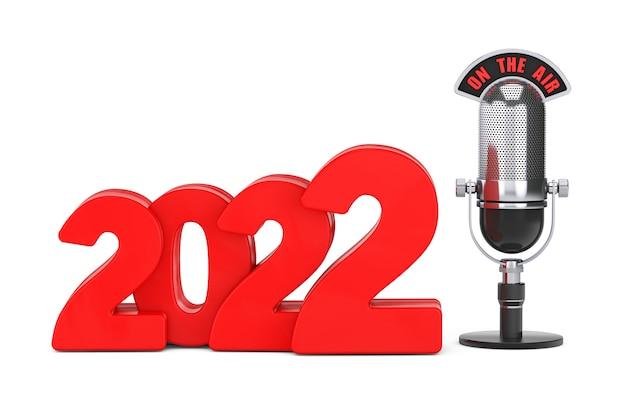 2022 nieuwjaarsconcept. rood 2022 nieuwjaarsbord met microfoon en on the air-teken op een witte achtergrond. 3d-rendering