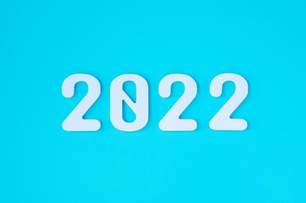 2022 wit tekstnummer op blauwe achtergrond. resolutie, plan, beoordeling, doel, start en nieuwjaarsvakantieconcepten