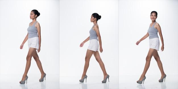 20s fashion jonge dunne aziatische vrouw tan huid haar mooie make-up mode grijze enorme witte korte broek poseren. studio lighting witte geïsoleerde achtergrond, collagegroepspakket lopen op schoenen met hoge hakken