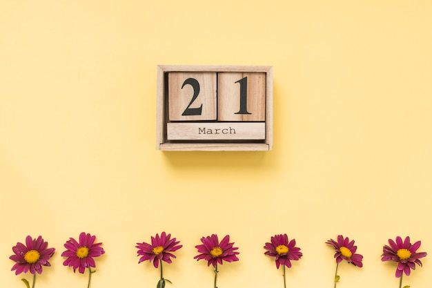 21 maart-inscriptie met roze bloemen