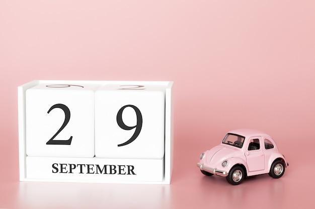 29 september. dag 29 van de maand. kalenderkubus met auto