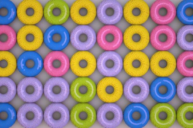 3d-graphics, kleurrijke donuts in glazuur liggen in rijen. meerdere rijen ronde donuts, isometrische modellen. donuts op een blauwe achtergrond. detailopname.