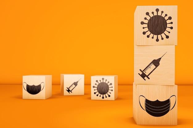 3d houten kubussen met covidpictogrammen op gele achtergrond.