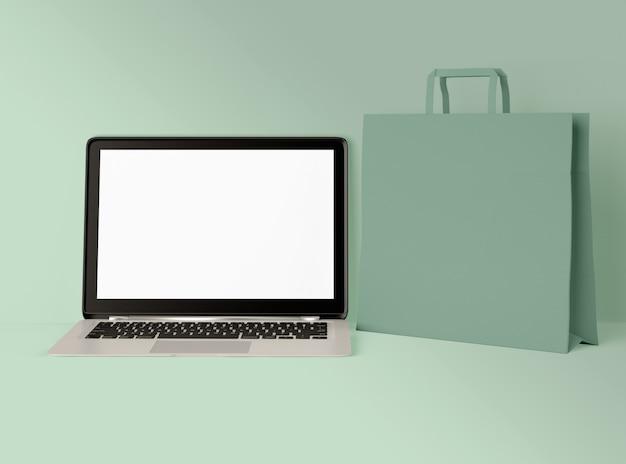 3d illustratie. laptop met boodschappentas.