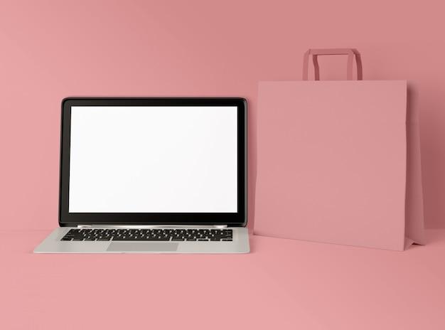3d illustratie. laptop met wit scherm en boodschappentas.