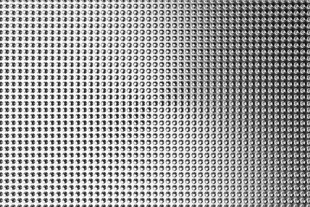 3d illustratie van rijen metalen hobbels. een reeks puistjes op een monochrome achtergrond, patroon. geometrische achtergrond