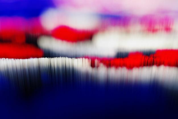 3d render van abstract van surrealistische 3d scatter topografische landschap achtergrond met abstracte vallei met heuvels op basis van kleine lange blokjes of stokken deeltjes in rood blauw wit en zwart kleur