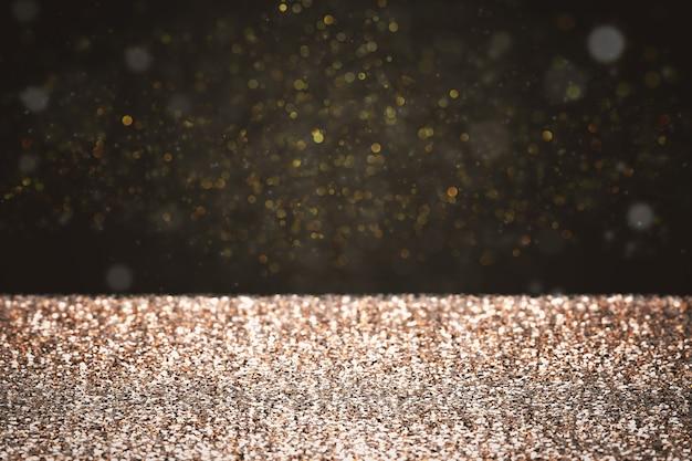 3d-rendering gouden glitter met bokeh op zwarte achtergrond