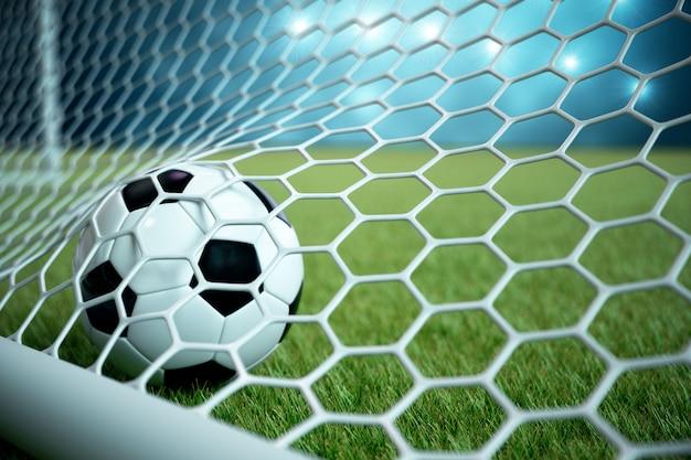 3d-rendering voetbal in doel. voetbalbal in netto met schijnwerper en stadionlicht, succesconcept. voetbalbal op blauw met gras.