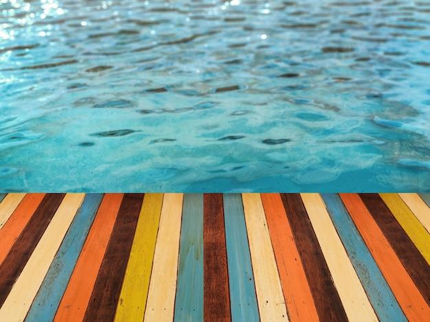3d rendering zwembadzijde met houten vloer