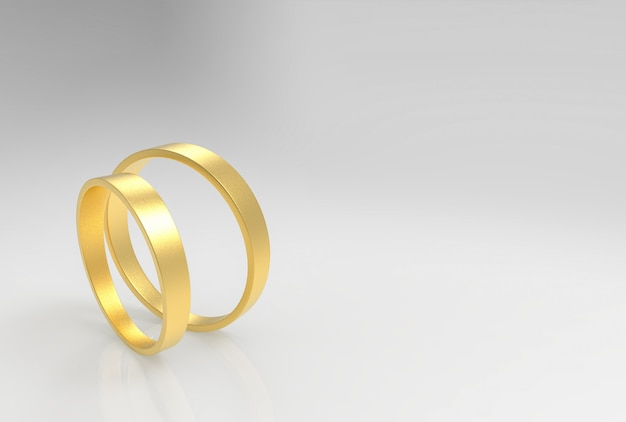3d-weergave. een paar eenvoudige gouden ringen op grijze achtergrond.