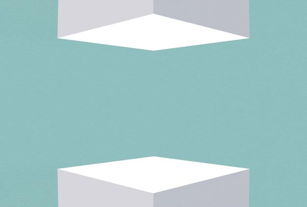 3d-weergave. lege witte kubus doos op en neer met blauwe saffier cement muur ontwerp achtergrond.