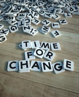 3d-weergave van de woorden tijd voor verandering geschreven in lettertegels