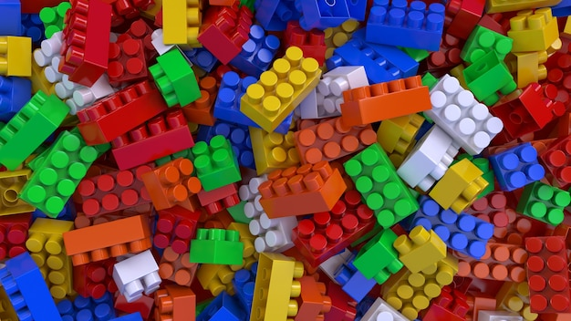 3d-weergave van een heleboel kleurrijke speelgoed plastic bakstenen voor kinderen