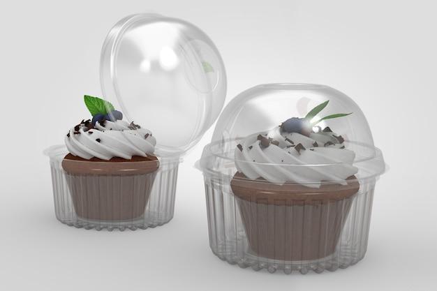 3d-weergave van een lege transparante cup cake containers geïsoleerd op een witte achtergrond. geschikt voor uw ontwerpproject. twee bosbessencupcakes toegevoegd