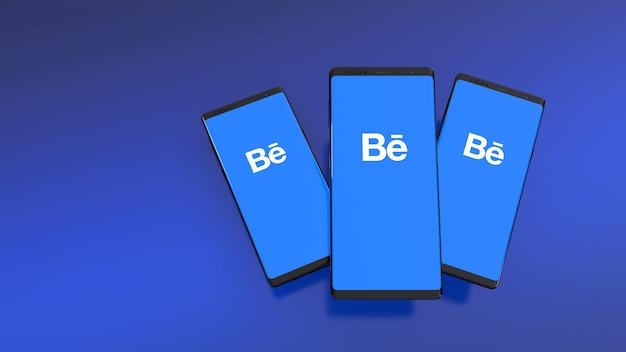 3d-weergave van smartphones met behance-logo op het scherm