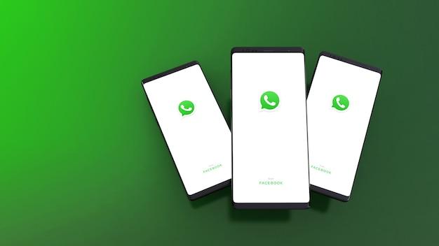 3d-weergave van smartphones met whatsapp-logo op het scherm