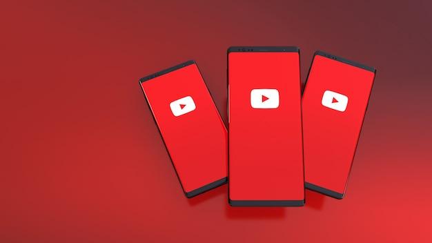 3d-weergave van smartphones met youtube-logo op het scherm