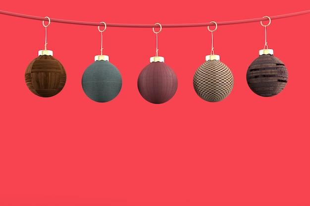 5 kerstballen op rode achtergrond
