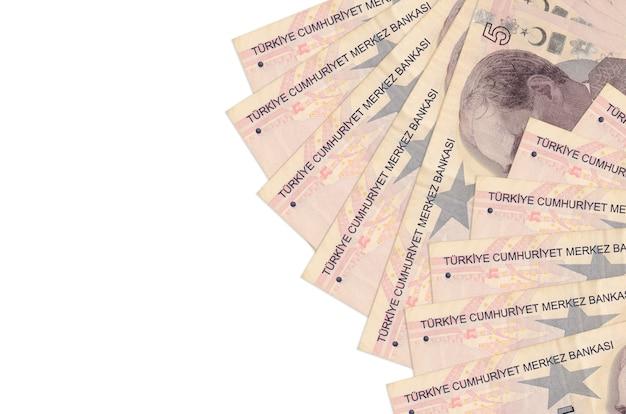 5 turkse lira's rekeningen liggen geïsoleerd op een witte muur met kopie ruimte. rijke leven conceptuele muur. grote hoeveelheid rijkdom in nationale valuta
