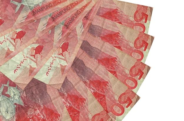 50 filippijnse piso-rekeningen liggen geïsoleerd gestapeld in waaiervorm close-up. financiële transacties concept