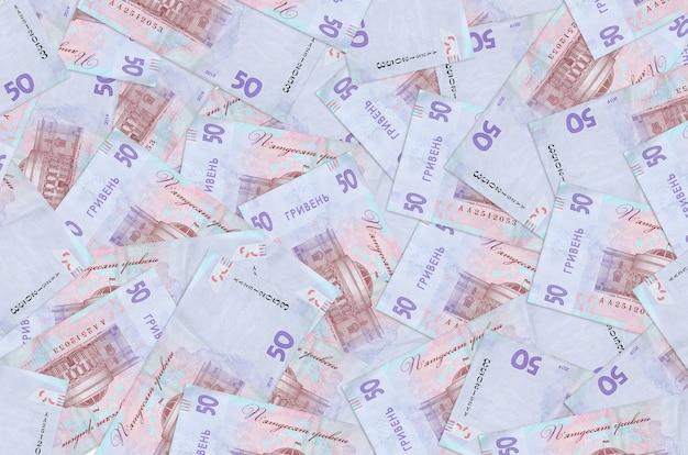 50 oekraïense hryvnia-rekeningen liggen op een grote stapel