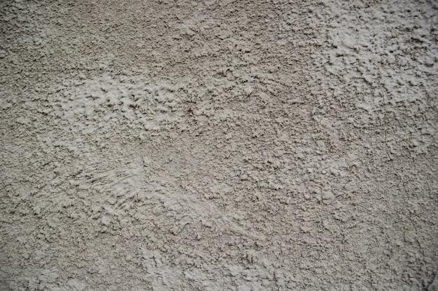 A close up van een grijze muur. oude gestructureerde achtergrond met abstract stucwerk.