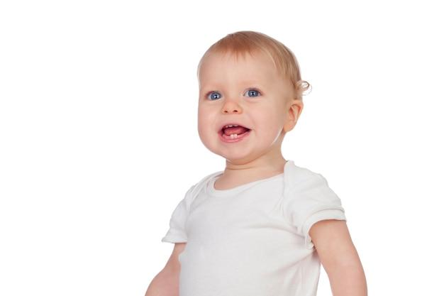 Aanbiddelijke blonde baby in ondergoed het glimlachen